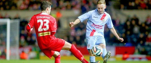 Cliftonville midfielder Tomas Cosgrove challenges Sky Blues defender Stephen McBride