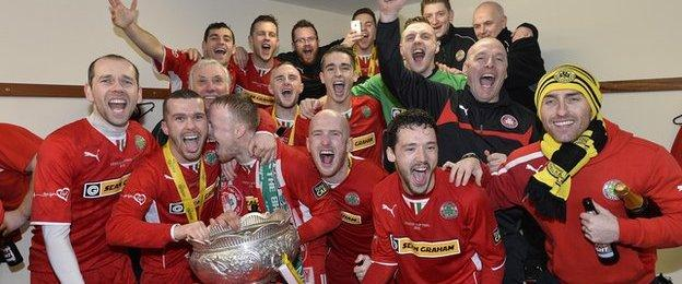 A familiar sight in local football - Cliftonville celebrating another League Cup success