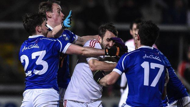 Cavan players surround Tyrone's Mark Donnelly in the Athletic Grounds final