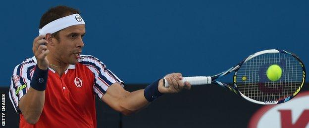 Gilles Muller in action at the Australian Open