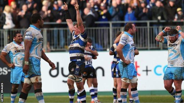 Bath celebrate as the Glasgow players look on dejected