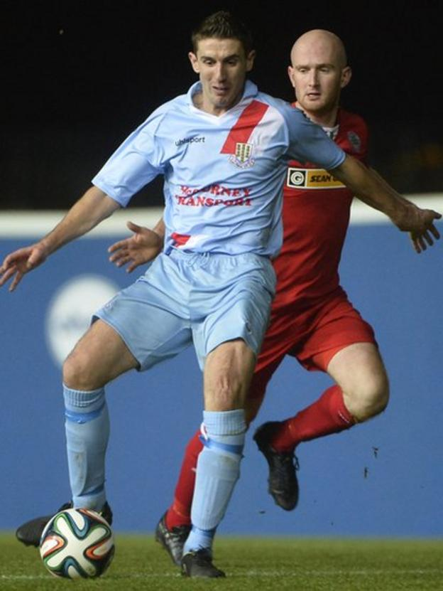 Ballymena United midfielder Gary Thompson on the ball as Cliftonville opponent Ryan Catney closes in