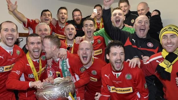 The party begins in the Cliftonville changing room after the Belfast side beat Ballymena United 3-2 in the 2014-15 Irish League Cup final