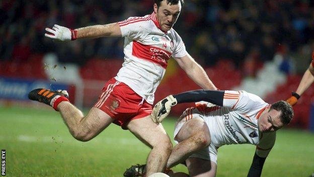 Philip McEvoy attempts to get down to block an Emmet McGuckin shot in a game between Armagh and Derry in 2013