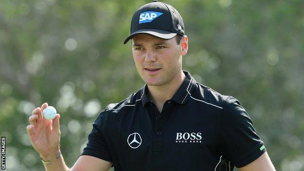 Martin Kaymer of Germany waves to the crowd during the third round of the Abu Dhabi Championship