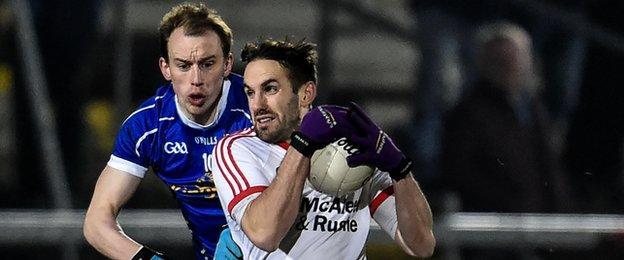 Mark Donnelly battles with Cavan's Martin Reilly in Saturday's McKenna Cup final