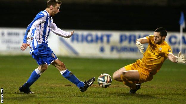 Coleraine's Ian Parkhill and Glenavon goalkeeper James McGrath
