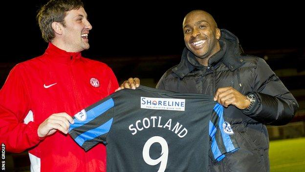 Jason Scotland shares a joke with player-manager Martin Canning