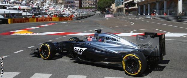 Jenson Button's McLaren tackles the Swimming Pool section in Monaco