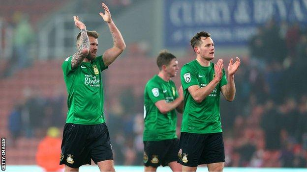 Wrexham players sport their away kit in their recent FA Cup tie at Stoke City