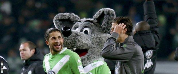 Wolfsburg players and mascot