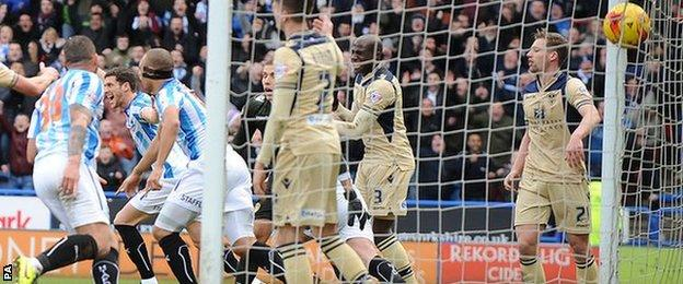 Harry Bunn celebrates his equaliser for Huddersfield against Leeds