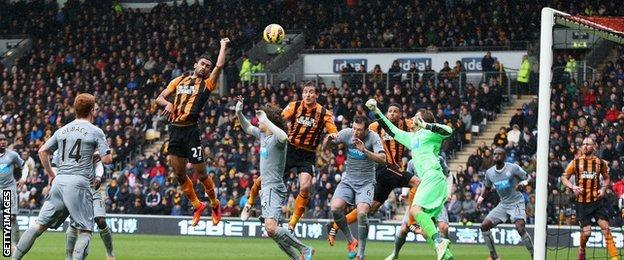 Ahmed Elmohamady of Hull City punches the ball into the Newcastle net