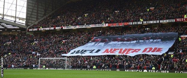 A banner is displayed at Old Trafford as Manchester United commemorate the 57th anniversary of the Munich Air Disaster before kick-off