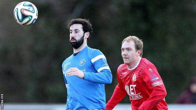 Ballinamallard's Johnny Lafferty is about to be challenged by Portadown's Ross Redman