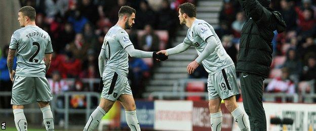 Danny Ings shakes the hand of Lukas Jutkiewicz as he is substituted