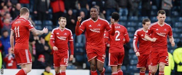 Donervon Daniels celebrates his headed goal for Aberdeen