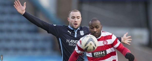 James McPake challenges Accies' Jason Scotland