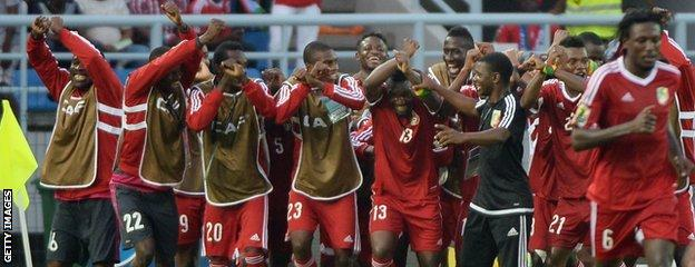 Thievy Bifouma (centre) is mobbed after scoring Congo's second but they could not hold the lead