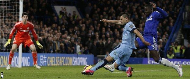 Chelsea's Kurt Zouma challenges Man City striker Sergio Aguero