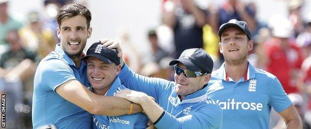 England celebrate the wicket of Mitchell Marsh