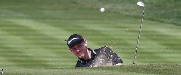 Stephen Gallacher plays a bunker shot in Sunday's final round in Dubai
