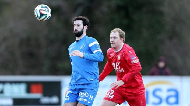 Johnny Lafferty holds the ball up as Ross Redman keeps a close eye at Ferney Park