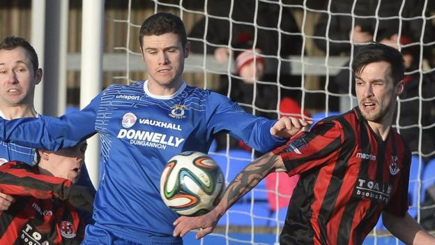 Gary Liggett and Declan Caddell vie for possession as Dungannon draw 1-1 with league leaders Crusaders