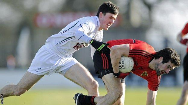 Kildare's Mick O'Grady challenges Down's Kevin McKernan in Newbridge