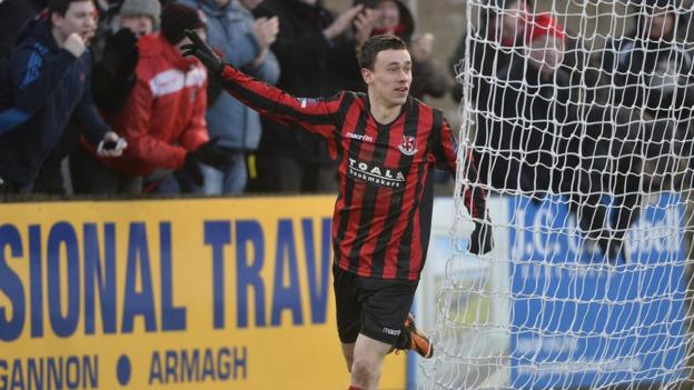 Paul Heatley takes the acclaim of Crusaders supporters after netting his side's equaliser at Stangmore Park