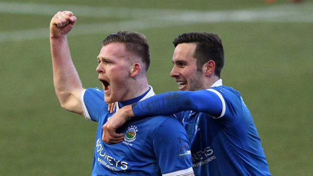 Ross Clarke celebrates with Andy Waterworth after firing home Linfield's winning goal against Ballymena United at Windsor Park