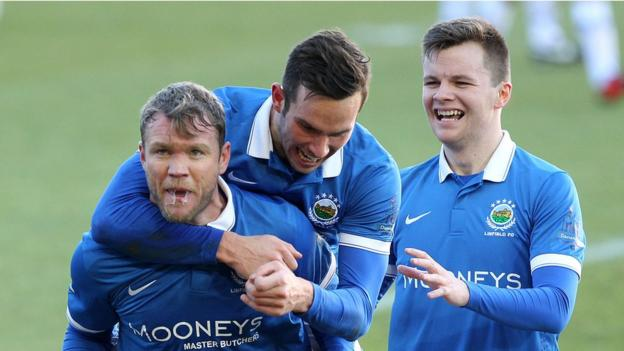 Northern Ireland international Grant McCann was on target for Linfield on his home debut for the club