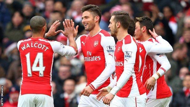 Olivier Giroud (centre) celebrates scoring Arsenal's opening goal