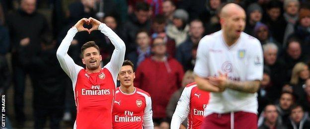 Olivier Giroud (left) celebrates his opening goal for Arsenal