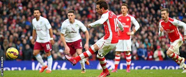 Santi Cazorla scores from the penalty spot