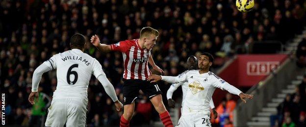 James Ward-Prowse of Southampton rises above Kyle Naughton of Swansea City