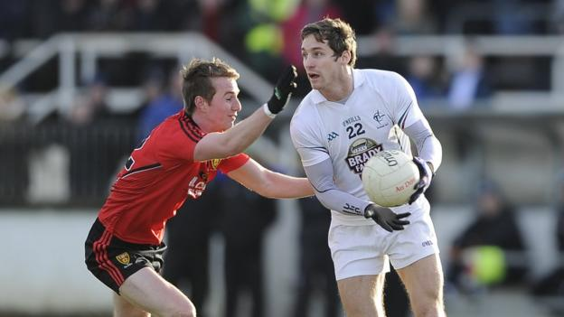 Down's Paul Devlin tries to get to grips with Gary White of Kildare in Sunday's Football League game