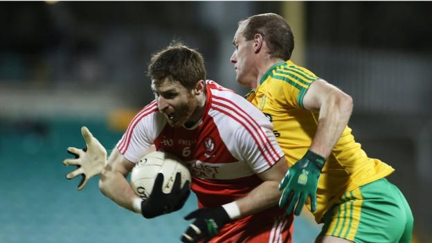 Derry's Gerard O'Kane shields the ball from Neil Gallagher as Donegal win the Ulster derby at Ballybofey