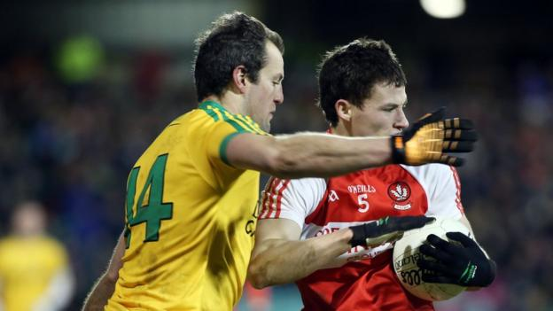 Michael Murphy attempts to block the progress of Kevin Johnston as Donegal see off Derry 1-15 to 0-12 in Division One