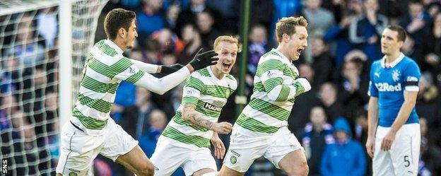 Kris Commons (right) celebrates scoring Celtic's second goal