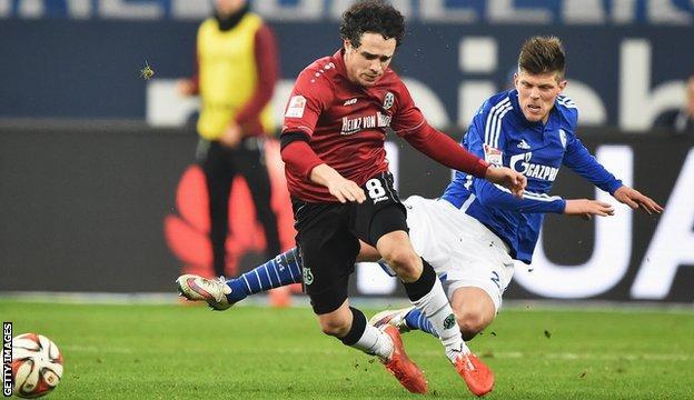 Klaas-Jan Huntelaar of Schalke brings down Manuel Schmeidebach of Hannover