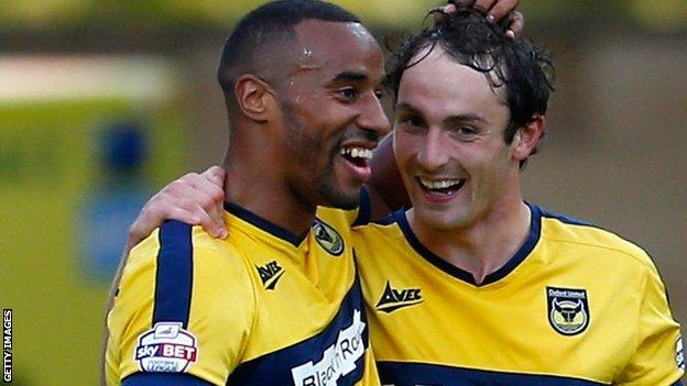 Tyrone Barnett (l) with Oxford United team-mate Danny Hylton