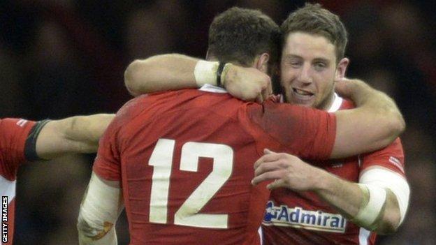 Dan Biggar, Jamie Roberts and Alex Cuthbert celebrate in 2013 against England