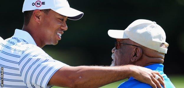 Charlie Sifford with Tiger Woods