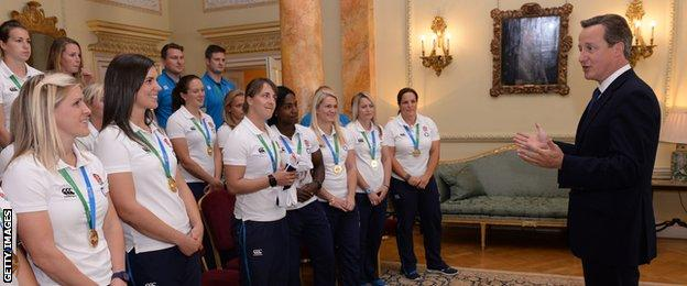 Prime Minister David Cameron and the England women's rugby team