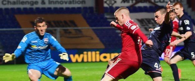 County's Paul Quinn moves in to tackle Aberdeen winger Jonny Hayes