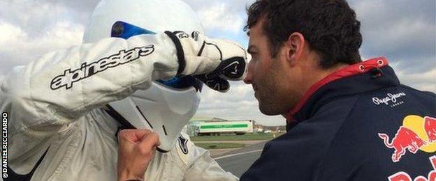 Daniel Ricciardo and The Stig square up on the racetrack