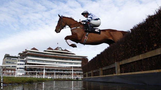 Jockey Jamie Moore riding Top Gamble clears the water jump at Newbury racecourse