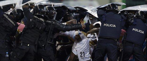 Riot police shield Ghana players