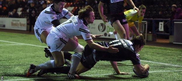Joel Tomkins goes over for the opening try of the game